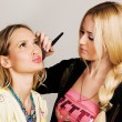 Professional visagiste applying makeup — Stock Photo