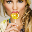 Fashionable young woman holding a candy — Stock Photo #5728122