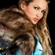 Gorgeous young woman with fur clothing — Stock Photo