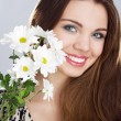 Beautiful young woman with flowers — Stock Photo #5728230