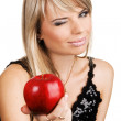 Young woman giving an apple — Stock Photo