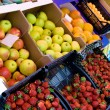 Fresh fruit and vegetables on a market - Stock Photo