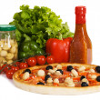 Pizza with sauce and vegetables - Stock Photo