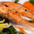 Salmon served with olives and lemon - Photo