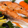 Salmon served with olives and lemon - Stock Photo