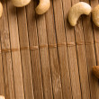 Nuts on bamboo background — Stock fotografie