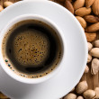 Coffee with nuts on background — Foto Stock