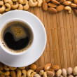 Coffee with nuts on background — Stock Photo
