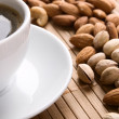 Stock Photo: Cup of coffee and nuts