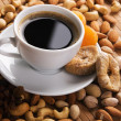 Coffee with nuts, fig and dried apricots — Stock Photo