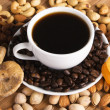 Coffee with nuts, fig and dried apricots - Stock Photo