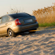 Stock Photo: Car stuck in sand