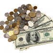Hunder dollar bills and a heap of coins — Stock Photo