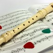 Flute lying on notes sheet — Stock Photo