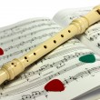 Flute lying on notes sheet - Stock Photo