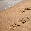 Stock Photo: Footprints on sand