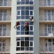 Stock Photo: Steeplejacks working on a new house