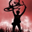 Silhouette of biker holding his bicycle — 图库照片 #5729783