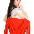 Beautiful lady trying on a red dress — Stock Photo