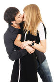 Young elegant couple is kissing — Stock Photo