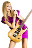 Young lady playing an electric guitar — Stock Photo
