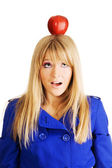 Funny young woman with an apple on her head — Stock Photo