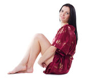 Beautiful woman in red dressing gown — Stock Photo