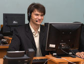 Young businessman in his office — Stock Photo