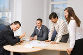 Office workers having a discussion — Stock Photo