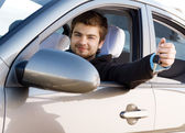 Young man driving a car — Stock Photo