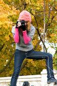 Cute girl taking a photograph — Stock Photo
