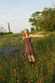 Beautiful young woman in a field — Stock Photo