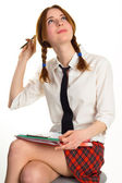 Beautiful lady writing on a worksheet — Stock Photo