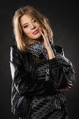 Pretty elegant woman in black leather jacket — Stock Photo