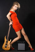 Extravagant model with a music equipment — Stock Photo