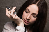 Beautiful lady with a bottle of perfume — Stock Photo