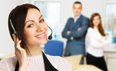 Young beautiful call center operator — Stock Photo