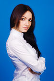 Beautiful brunette in a white shirt — Stock Photo