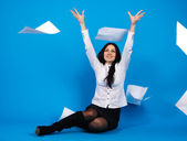 Yong beautiful businesswoman throwing paper away — Stock Photo