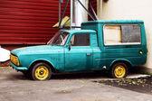 Old worn blue car — Stock Photo