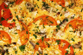 Pizza with tomatoes and champignons — Stock Photo