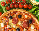Pizza with vegetables and cherry tomatoes — Stock Photo