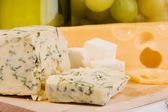 Different sorts of cheese closeup photo — Stock Photo