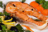 Salmon served with olives and lemon — Stock Photo