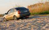 Car stuck in sand — Stock Photo
