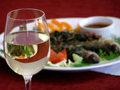Wineglass with a dish — Stock Photo