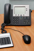 Digital phone on office table — Stockfoto