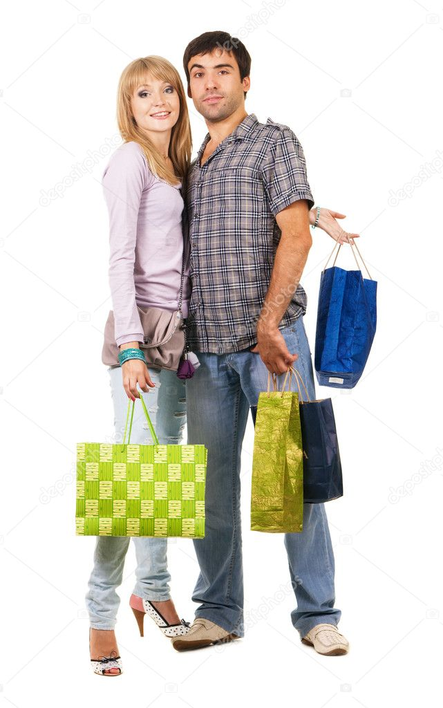 Beautiful young couple with shopping bags, isolated on white background   Stock Photo #5725961