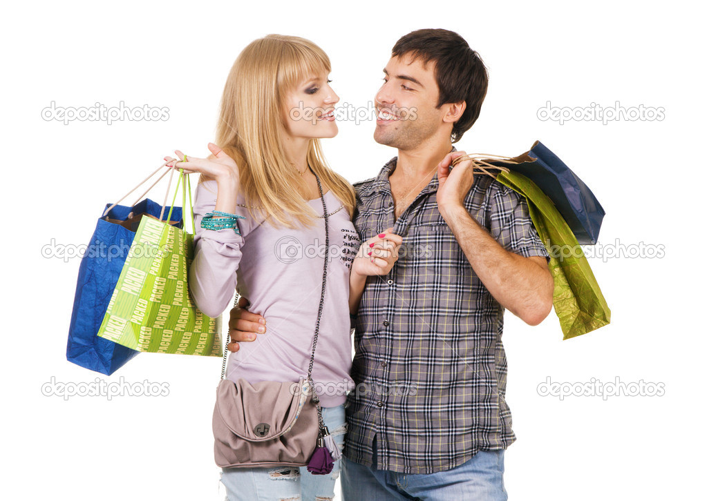 Cheerful young couple with shopping bags, isolated on white background  — Stock Photo #5725967