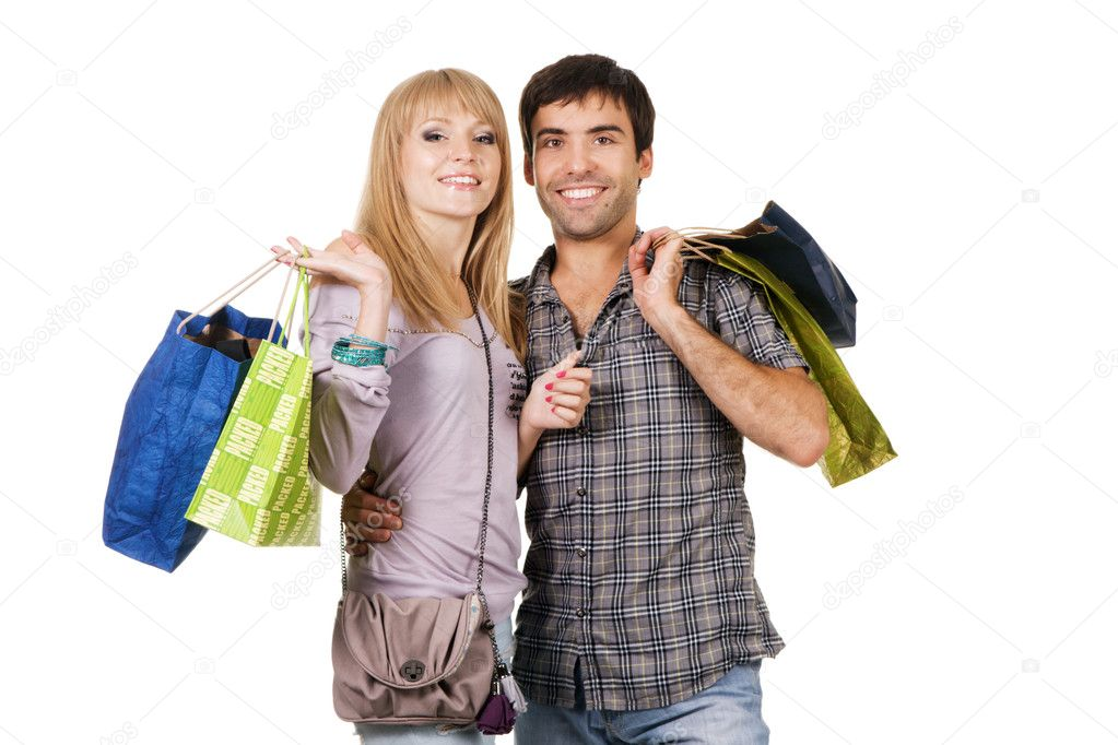 Beautiful young couple with shopping bags, isolated on white background  Stock Photo #5725968